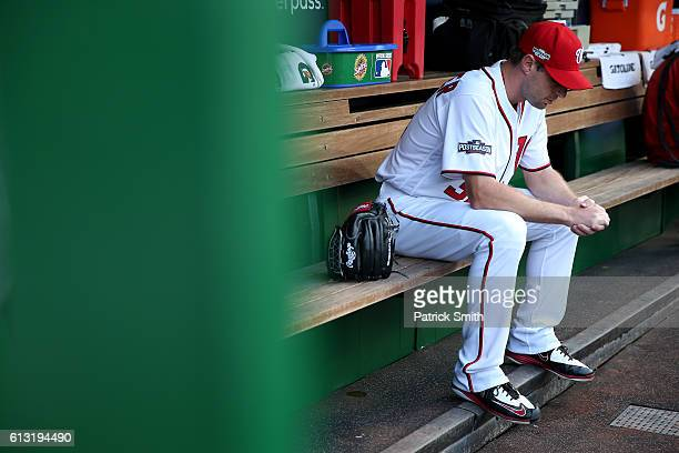 Max Scherzer of the Washington Nationals looks on from the dugout against the Los Angeles Dodgers prior to game one of the National League Division...