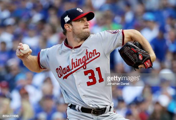Max Scherzer of the Washington Nationals pitches in the first inning against the Chicago Cubs during game three of the National League Division...