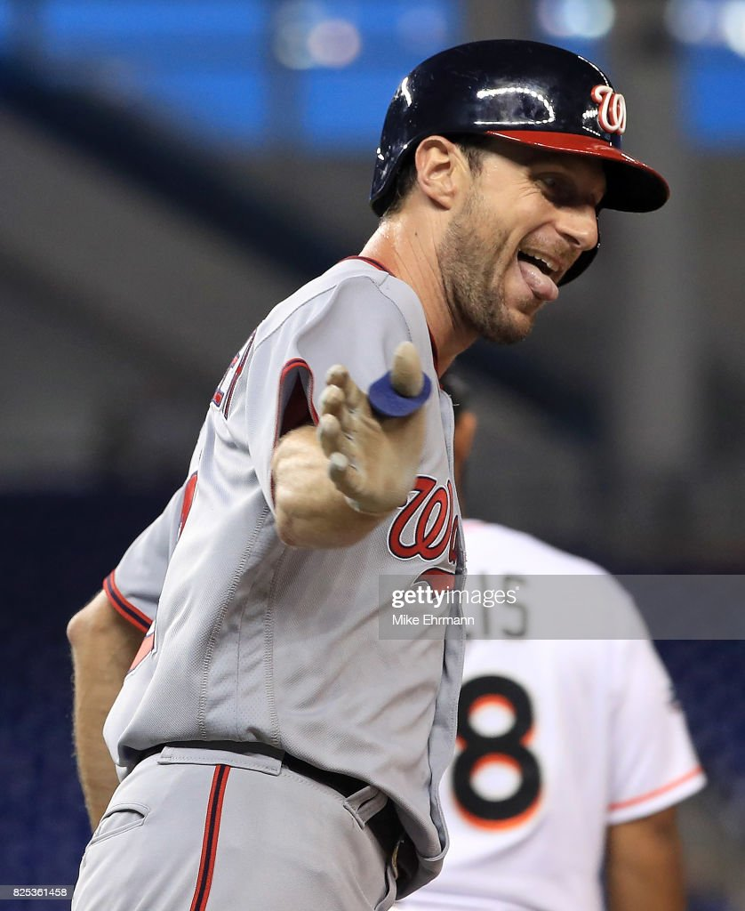 Max Scherzer #31 of the Washington Nationals reacts after hitting a three run home run in the second inning during a game against the Miami Marlins at Marlins Park on August 1, 2017 in Miami, Florida.
