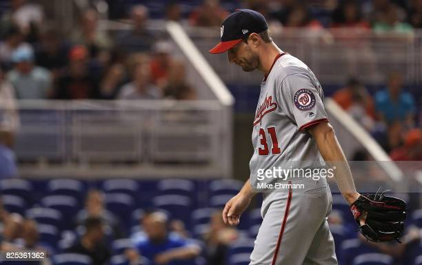 Max Scherzer of the Washington Nationals reacts after taking himself out of the game in the second inning with neck spasms during a game against the...
