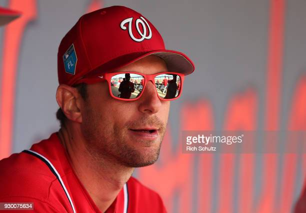 Max Scherzer of the Washington Nationals sits in the dugout during a spring training game against the New York Mets at FITTEAM Ball Park of the Palm...