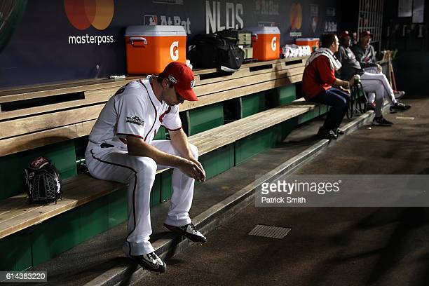 Max Scherzer of the Washington Nationals sits in the dugout prior to game five of the National League Division Series against the Los Angeles Dodgers...
