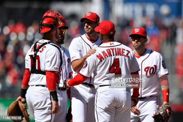 Max Scherzer of the Washington Nationals talks with manager Dave Martinez as he is removed from the game in the eighth inning against the New York...