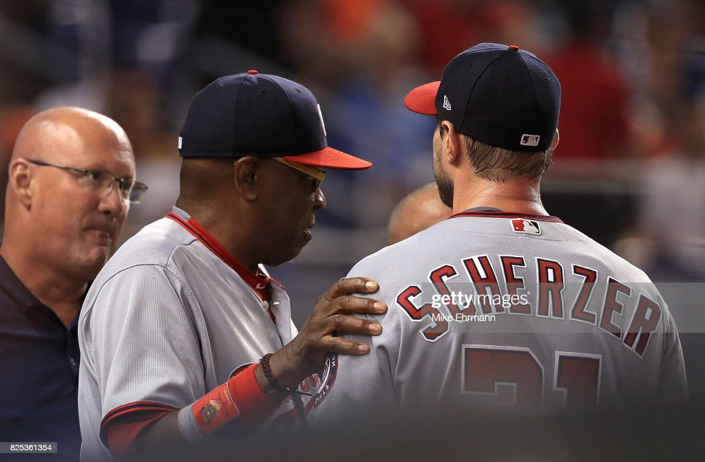 Max Scherzer #31 of the Washington Nationals talks with manager Dusty Baker #12 after taking himself out of the game in the second inning with neck spasms during a game against the Miami Marlins at Marlins Park on August 1, 2017 in Miami, Florida.
