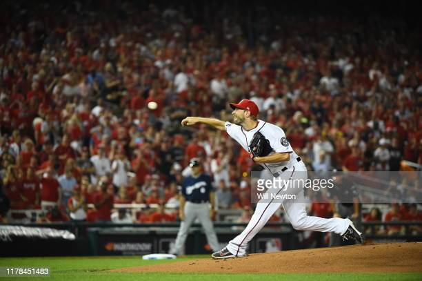 Max Scherzer of the Washington Nationals throws a pitch against the Milwaukee Brewers during the first inning in the National League Wild Card game...