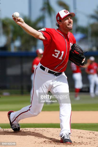 Max Scherzer of the Washington Nationals throws the ball during a morning workout prior to the spring training game against the Boston Red Sox at The...