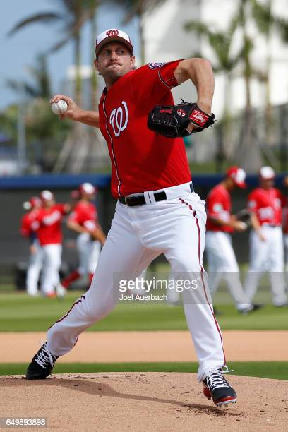 Max Scherzer of the Washington Nationals throws the ball prior to the spring training game against the Boston Red Sox at The Ballpark of the Palm...