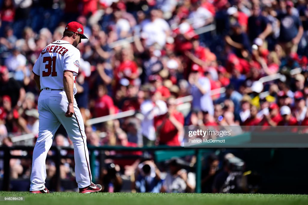 Max Scherzer #31 of the Washington Nationals walks back to the dugout after striking out Ian Desmond #20 of the Colorado Rockies (not pictured) to end the top of the seventh inning at Nationals Park on April 14, 2018 in Washington, DC.