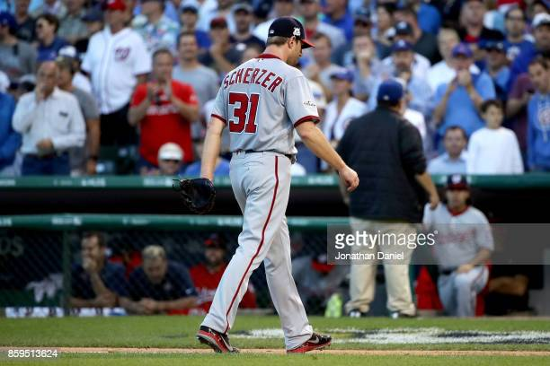 Max Scherzer of the Washington Nationals walks off the field after being relieved in the seventh inning against the Chicago Cubs during game three of...