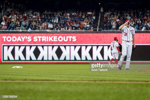 Max Scherzer of the Washington Nationals walks to the pitcher's mound after striking out the tenth batter of the Chicago Cubs during the eighth...
