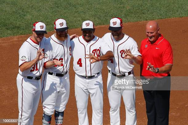 Max Scherzer Sean Doolittle manager Dave Martinez and Bryce Harper of the Washington Nationals and National League AllStars pose during Gatorade...