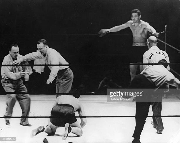 Max Schmeling the former champion is floored by Joe Louis during their World Heavyweight bout on June 22, 1938 at Yankee Stadium in the Bronx, New...