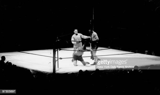 Max Schmeling versus Joe Louis I at Yankee Stadium Now Max closes in on his foe in the first round crouching looking for an opening to shoot over the...