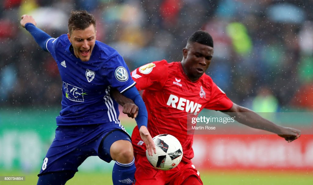 Max Schuemann (L) of Leher TS and Copete Cordoba of Koeln battle for the ball during the DFB Cup first round match between Leher TS and 1. FC Koeln at Nordseestadion on August 12, 2017 in Bremerhaven, Germany.