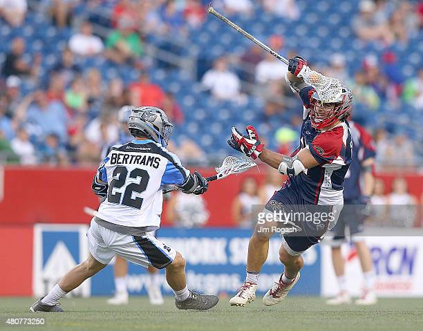 Max Seibald of Boston Cannons gets by Matt Bertrams of Ohio Machine in the second half at Gillette Stadium on July 11 2015 in Foxboro Massachusetts