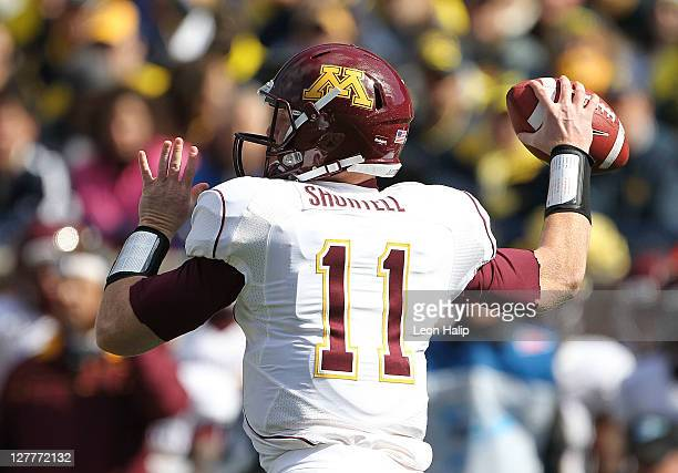 Max Shortell of the Minnesota Golden Gophers drops back to pass during the first quarter of the game against the Michigan Wolverines at Michigan...