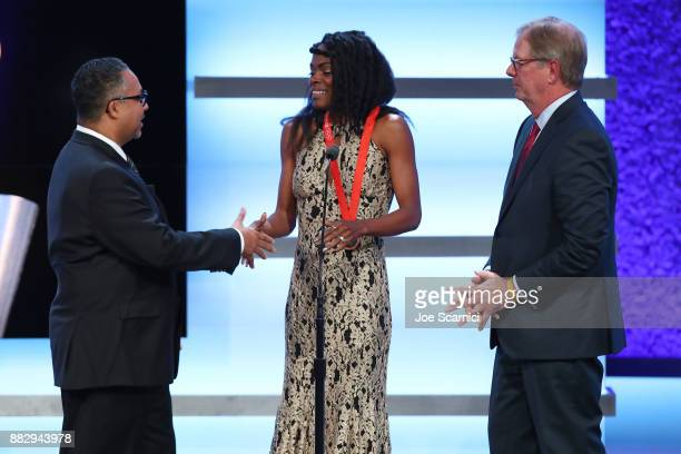 Max Siegel and Chaunte Lowe shake hands on stage after Lowe accepted her award during the 2017 Team USA Awards on November 29 2017 in Westwood...