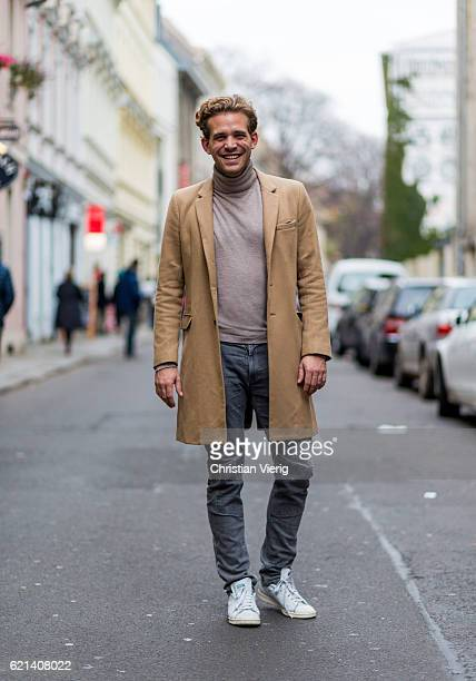 Max Simon wearing a beige turtleneck sweater a beige wool coat grey denim jeans and white sneakers on November 5 2016 in Berlin Germany