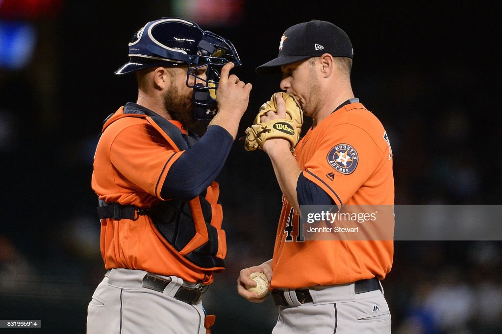 Max Stassi #12 and Brad Peacock #41 of the Houston Astros talk on the mound in the fourth inning of the MLB game against the Arizona Diamondbacks at Chase Field on August 15, 2017 in Phoenix, Arizona.