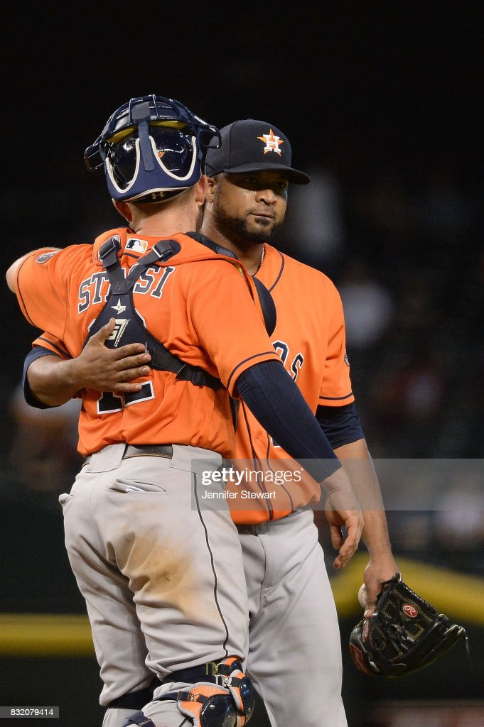 Max Stassi #12 and Francisco Liriano #35 of the Houston Astros hug after closing out the game against the Arizona Diamondbacks at Chase Field on August 15, 2017 in Phoenix, Arizona.