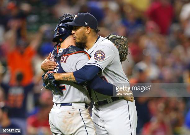 Max Stassi of the Houston Astros congratulates Hector Rondon for closing out the game for the win against the Texas Rangers at Globe Life Park in...