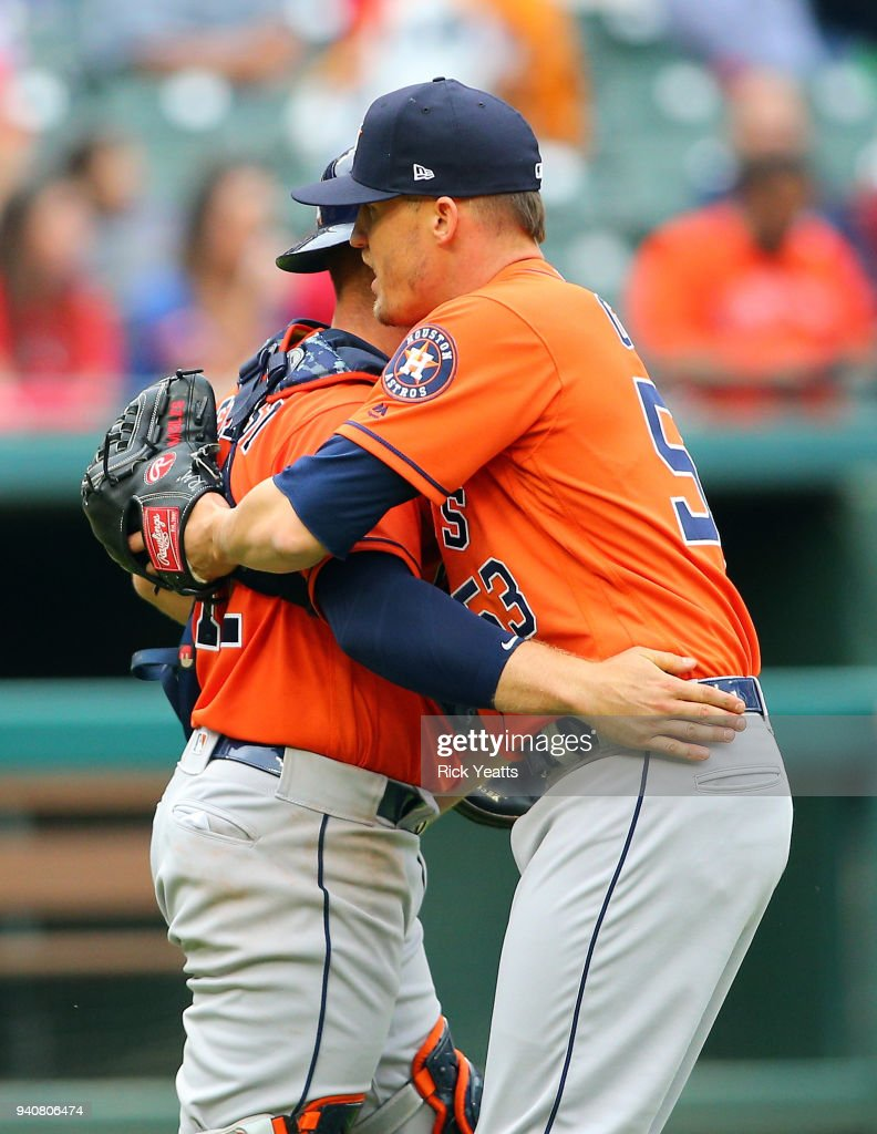 Max Stassi #12 of the Houston Astros congratulates Ken Giles #53 for closing out the game for the win against the Texas Rangers at Globe Life Park in Arlington on April 1, 2018 in Arlington, Texas.