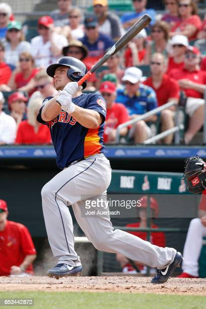 Max Stassi of the Houston Astros hits the ball against the St Louis Cardinals in the seventh inning during a spring training game at Roger Dean...