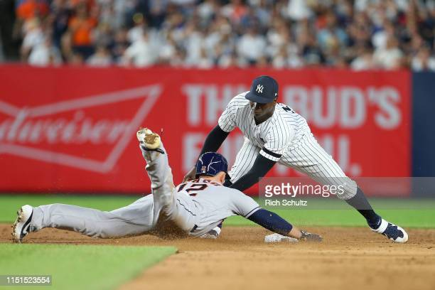 Max Stassi of the Houston Astros is tagged out by shortstop Didi Gregorius of the New York Yankees attempting to stretch a single into a double...