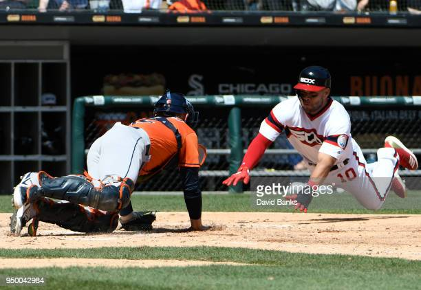 Max Stassi of the Houston Astros prepares to tag out Yoan Moncada of the Chicago White Sox at home plate during the third inning on April 22 2018 at...