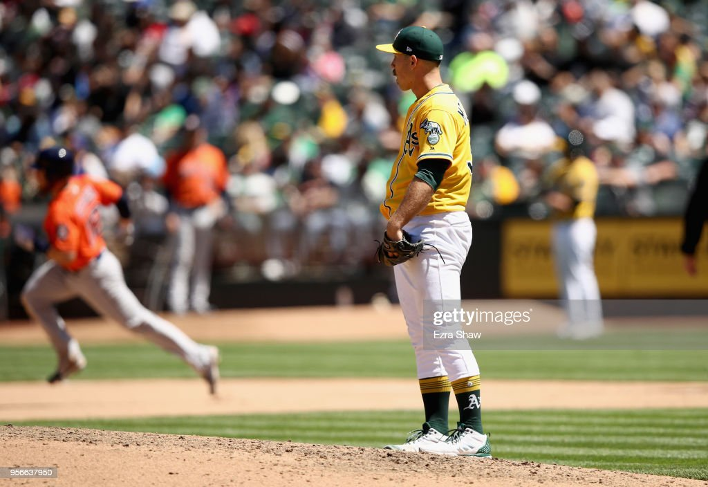 Max Stassi #12 of the Houston Astros rounds the bases after he hit a home run off of Daniel Mengden #33 of the Oakland Athletics in the seventh inning at Oakland Alameda Coliseum on May 9, 2018 in Oakland, California.