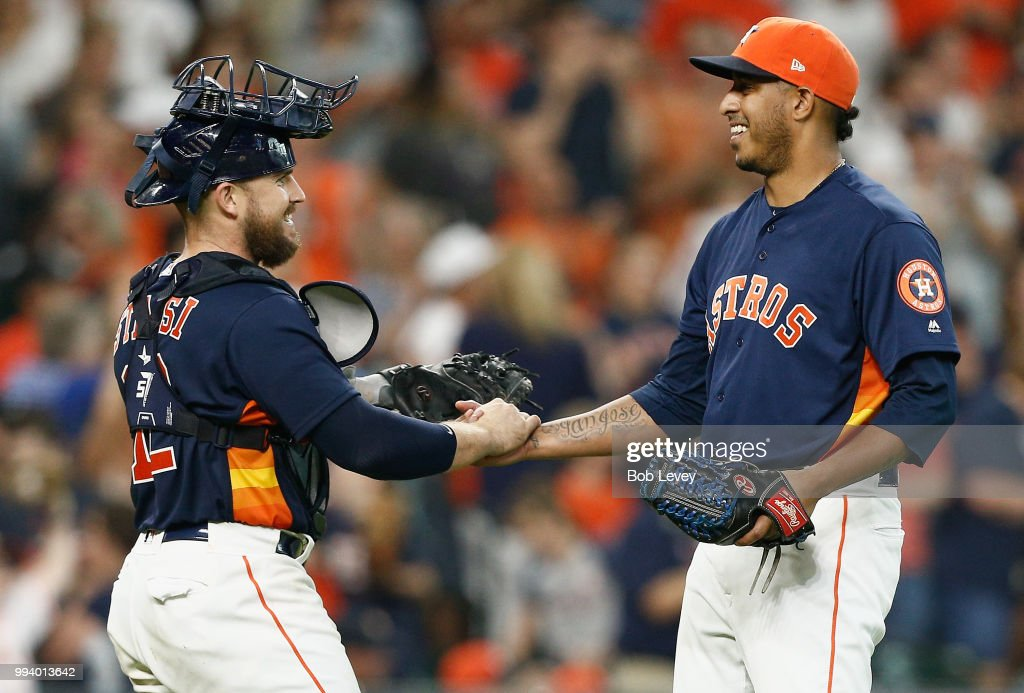 Max Stassi #12 of the Houston Astros shakes hands with Hector Rondon #30 after the final out against the Chicago White Sox at Minute Maid Park on July 8, 2018 in Houston, Texas.