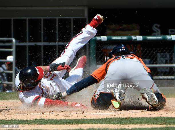 Max Stassi of the Houston Astros tags out Yoan Moncada of the Chicago White Sox at home plate during the third inning on April 22 2018 at Guaranteed...
