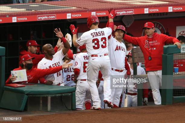 Max Stassi of the Los Angeles Angels celebrates as he walks back to the dugout after his home run in the third inning against the Kansas City Royals...