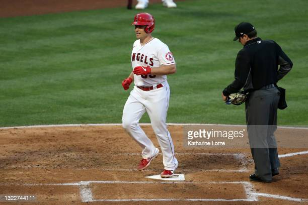 Max Stassi of the Los Angeles Angels crosses home plate after hitting a home run in the third inning against the Kansas City Royals at Angel Stadium...