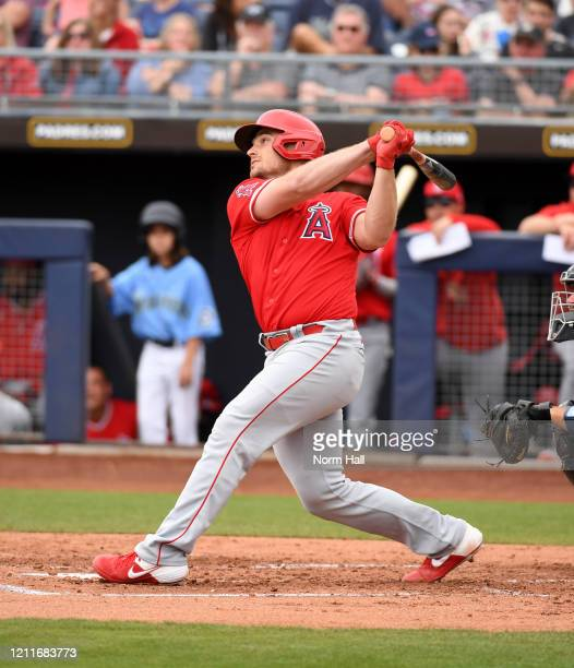 Max Stassi of the Los Angeles Angels follows through on a swing during a spring training game against the Seattle Mariners at Peoria Stadium on March...