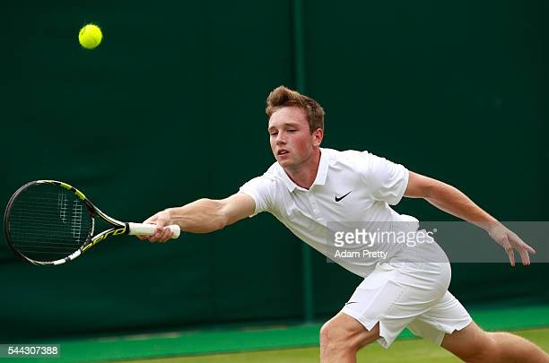 Max Stewart of Great Britain plays a forehand during the Boy's singles first round match against Daniel Altmaier of Germany on Middle Sunday of the...