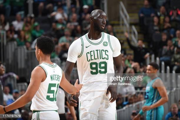 Max Strus of Boston Celtics highfives Tacko Fall of the Boston Celtics against the Charlotte Hornets on October 6 2019 at the TD Garden in Boston...