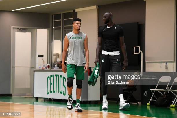Max Strus of the Boston Celtics shares a conversation with Tacko Fall of the Boston Celtics during practice on October 3 2019 at the Auerbach Center...