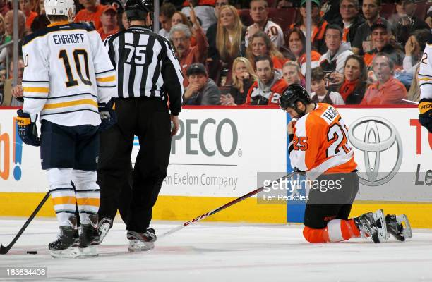 Max Talbot of the Philadelphia Flyers gets up slowly after being high checked in the face by Christian Ehrhoff of the Buffalo Sabres on March 10 2013...