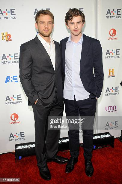 Max Thieriot and Freddie Highmore attend 2015 AE Networks Upfront on April 30 2015 in New York City