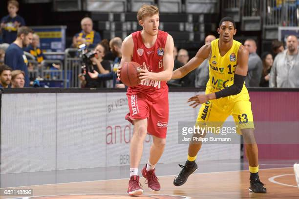 Max Ugrai of sOliver Wuerzburg and Malcolm Miller of Alba Berlin during the game between Alba Berlin and sOliver Wuerzburg on march 11 2017 in Berlin...