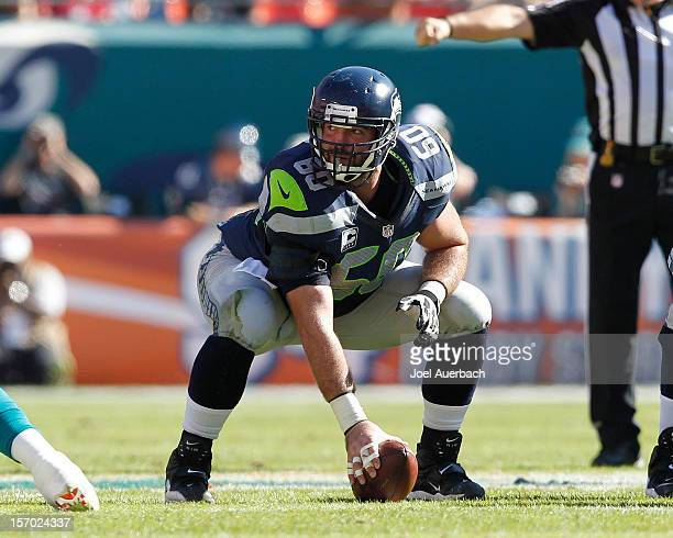 Max Unger of the Seattle Seahawks prepares to snap the ball against the Miami Dolphins on November 25 2012 at Sun Life Stadium in Miami Gardens...