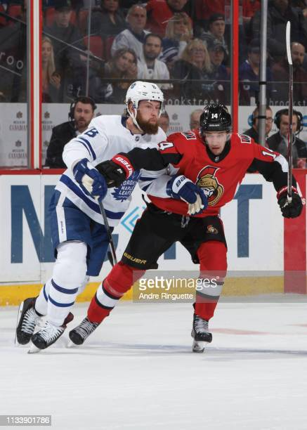 Max Veronneau of the Ottawa Senators battles for position against Jake Muzzin of the Toronto Maple Leafs at Canadian Tire Centre on March 30 2019 in...