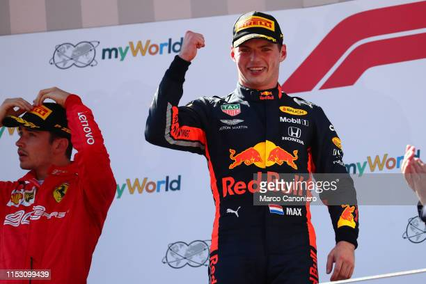 Max Verstappen of Aston Martin Red Bull Racing celebrates on the podium after the F1 Grand Prix of Austria.
