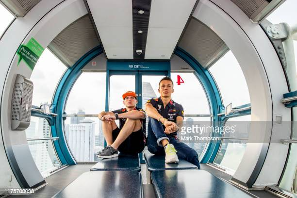 Max Verstappen of Netherlands and Red Bull Racing and Alexander Albon of Thailand and Red Bull Racing pose for a photo in the Singapore Flyer during...