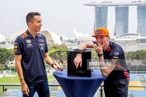 Max Verstappen of Netherlands and Red Bull Racing and Alexander Albon of Thailand and Red Bull Racing take part in a mystery box game during previews...
