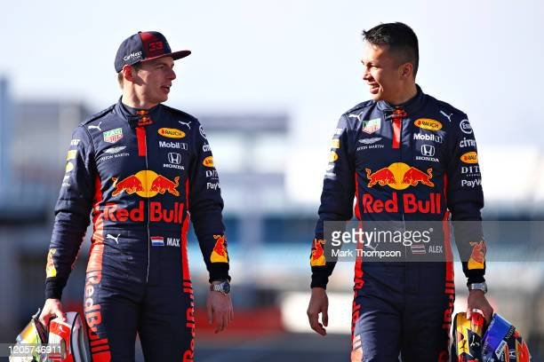 Max Verstappen of Netherlands and Red Bull Racing and Alexander Albon of Thailand and Red Bull Racing walk during the Red Bull Racing RB16 launch at...