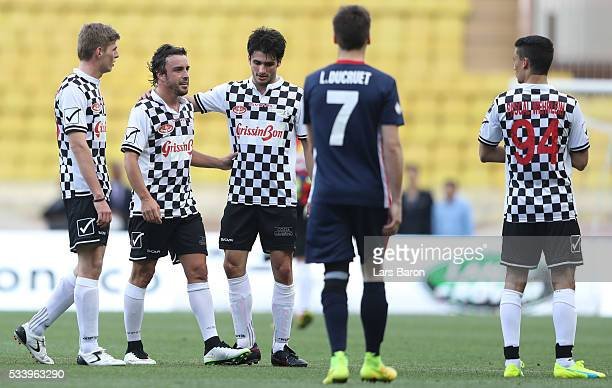 Max Verstappen of Netherlands and Red Bull Racing and Carlos Sainz of Spain and Scuderia Toro Rosso talk to Fernando Alonso of Spain and McLaren...