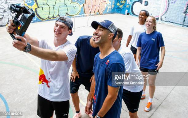 Max Verstappen of Netherlands and Red Bull Racing and Daniel Ricciardo of Australia and Red Bull Racing pose for a photo after playing futsal during...