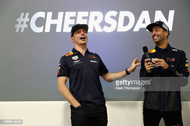 Max Verstappen of Netherlands and Red Bull Racing and Daniel Ricciardo of Australia and Red Bull Racing talk to the Red Bull Racing team during the...